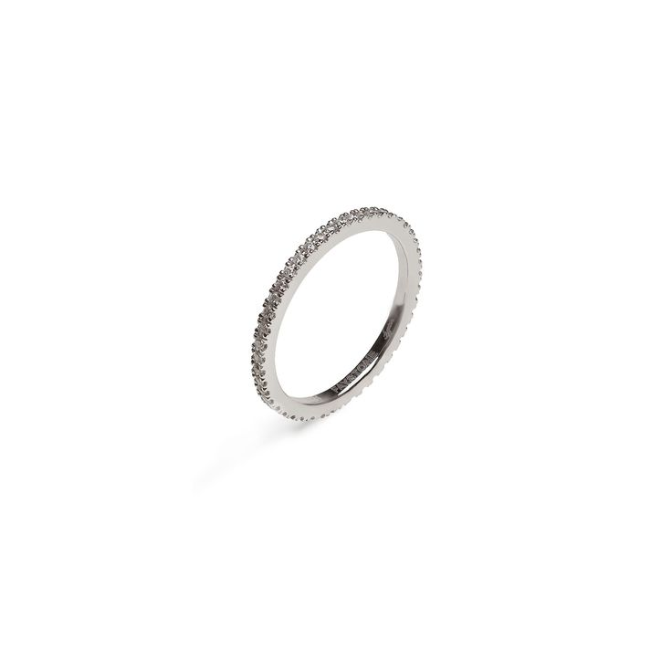 A chic 18K white gold band composed of sparkling brilliant cut diamonds, the Carina White ring is inspired by the stars that shine bright like diamonds in the sky.