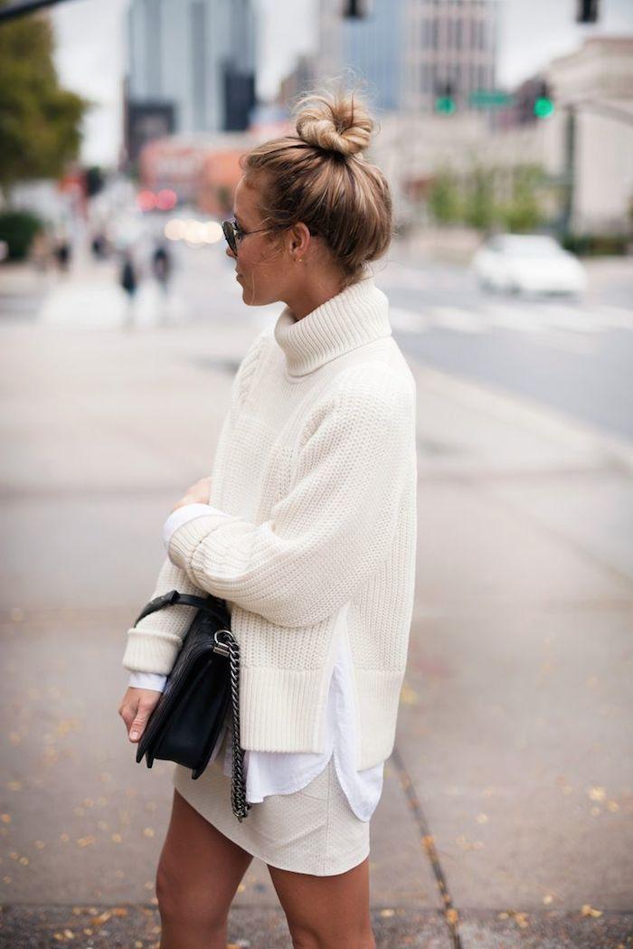 White turtleneck knit, mini skirt, and bun.