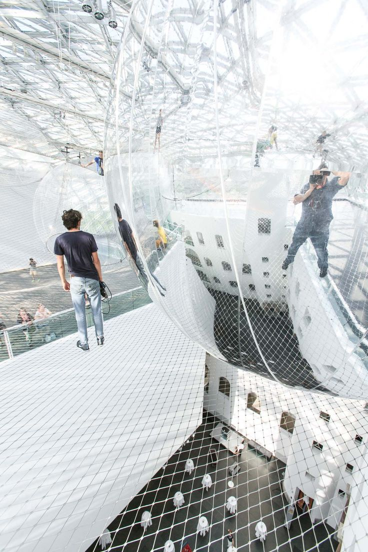 Artist and architect Tomás Saraceno created a massive layered installation  that's suspended more than 25 meters in the air of the Kunstsammlung ...
