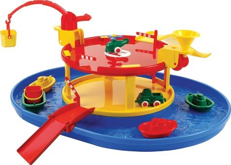This set includes a crane, a sand/water wheel, 2 ramps, a drawbridge, 4 gates, 3 boats, 1 barge, 2 vehicles and 1 helicopter. Made from soft, yet rugged plastic, it has rust proof axles and is dishwasher safe. Ages 12+ months