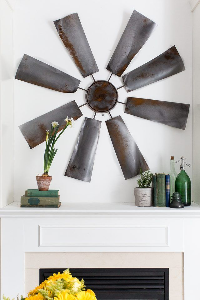 This windmill wall decor will make a great impact in your space and become a focal point on any wall.