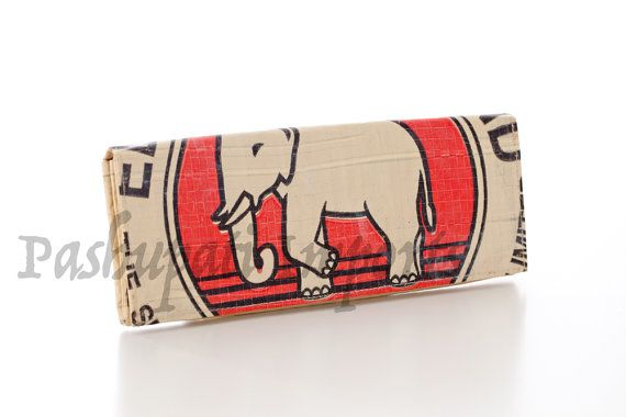 This is a lovely eye catching ladies wallet with a red white and black elephant design. Hand made from recycled cement bags, it is high quality,
