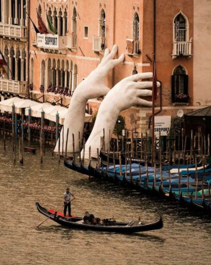 """#FridayFeature! These giant hands aren't a figment of your imagination, but are in fact part of an art installation called """"Support"""" in Venice. The hands are meant to symbolise the threat of climate change, but equally the power humanity has to prevent it. Thanks @hello_rooftops for sharing using #bbctravel, photo credit @jeypeg. #flights & #hotels #Cruises #RentalCars #mexico #lajolla #nyc #sandiego #sky #clouds #beach #food #nature #sunset #night #love #harmonyoftheseas #funny #amazing…"""