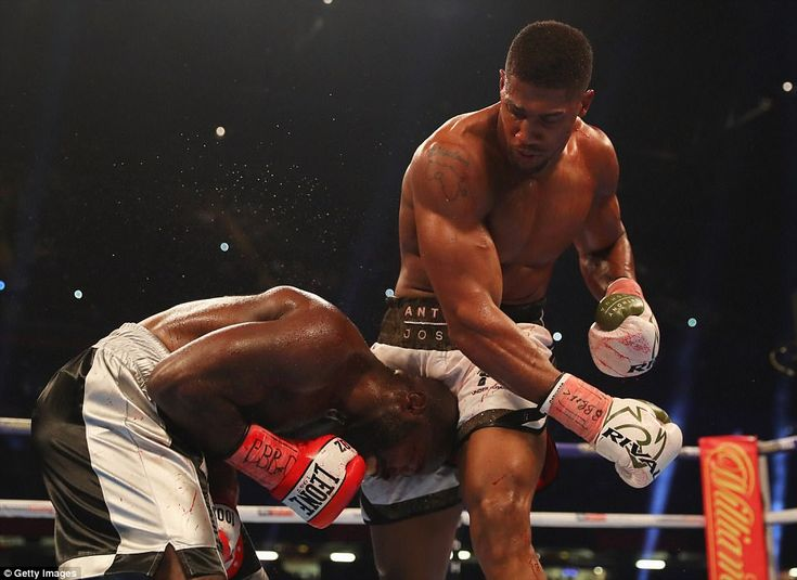 Joshua towers over his opponent after raining down a barrage of punishment on Takam in the middle rounds