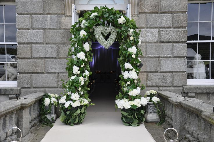 Floral Arch Way and White Carpet runner.  Visit www.gotchacovered.ie for more.
