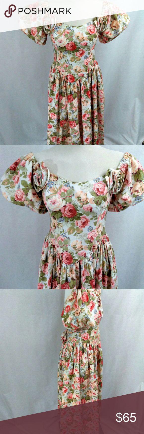 "Vintage Jessica McClintock Floral Dress Stunning floral Dress by Jessica McClintock. Sleeves can be worn on the shoulders or off. The fairy tale designer. Measurements: armpit to armpit 19"", waist 30"", top of bodice to hem 42"" Jessica McClintock Dresses"