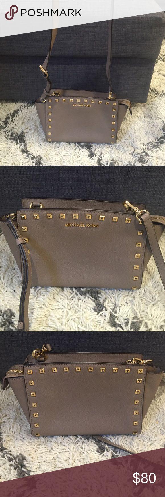 Michael Kors Salma Handbag Gorgeous Michael Kors Salma crossbody Handbag. Gold stud detail and hardware. Top zip closure with one pocket in interior. Adjustable strap. MICHAEL Michael Kors Bags Crossbody Bags