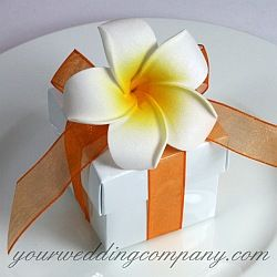 Foam frangipani (plumeria) flower wedding favor box design.  DIY handmade wedding favor idea via www.yourweddingcompany.com