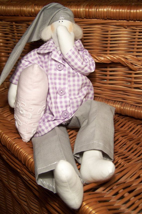 Adorable soft mascot holding little pillow with your chosen name or inscription on it. Pretty doll made of high quality cotton dressed in beautiful handmade pyjamas.