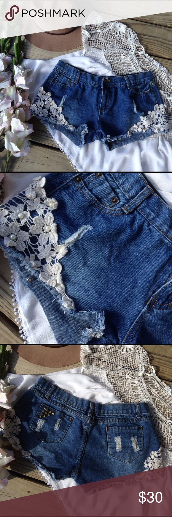 "Adorable Lace & Pearl Trim Cutoff Jean Shorts No size listed so Ill list the measurements below.34"" waist length 11-11.5"". Inseam 2-2-5""   No flaws free gift with purchase these do run very small Shorts Jean Shorts"