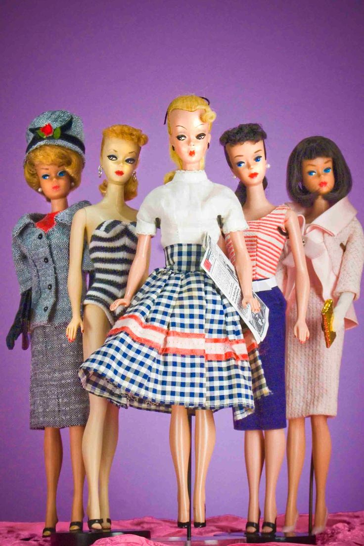 Vintage Barbie.  Mine was the one onf the left, with the hat.  Still have her