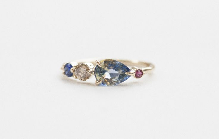 PEAR CUT BICOLOR SAPPHIRE, CHAMPAGNE DIAMOND, AND RUBY LINE CLUSTER RING Image