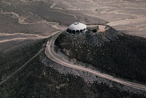 The Volcano House, 50451 Silver Valley Road, Valley Springs, California 92365. $750,000. Sited upon small volcanic cone in the high desert midway between Las Vegas & Los Angeles, this is a 60-acre retreat. Concrete and truss beams form its dome providing a 360 degree view of the of desert landscape. Main house of two bedrooms, 2 baths and open entertaining areas. Guest house of one bedroom and bath, and lake. Not the most exciting architecture, but it's on a freakin' volcano! (via Modern…
