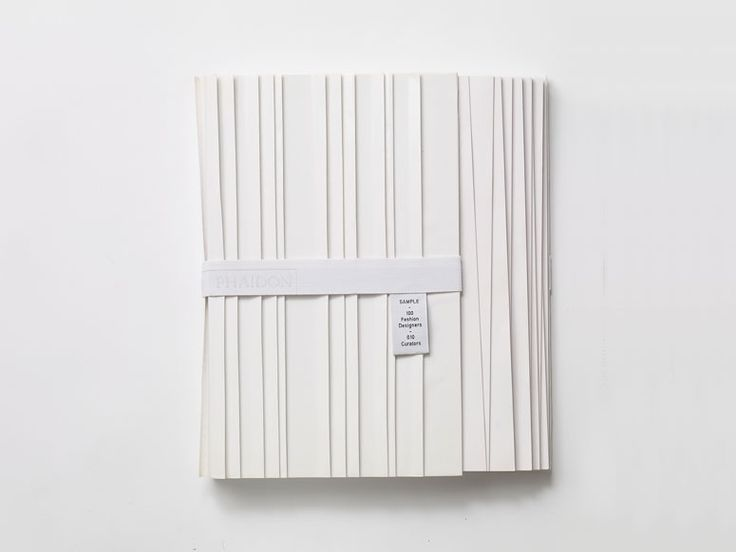 Material: white pleated paper, elastic strap / Process: uneven trimming, embroidery, lithography / Technique: light and shadow effect