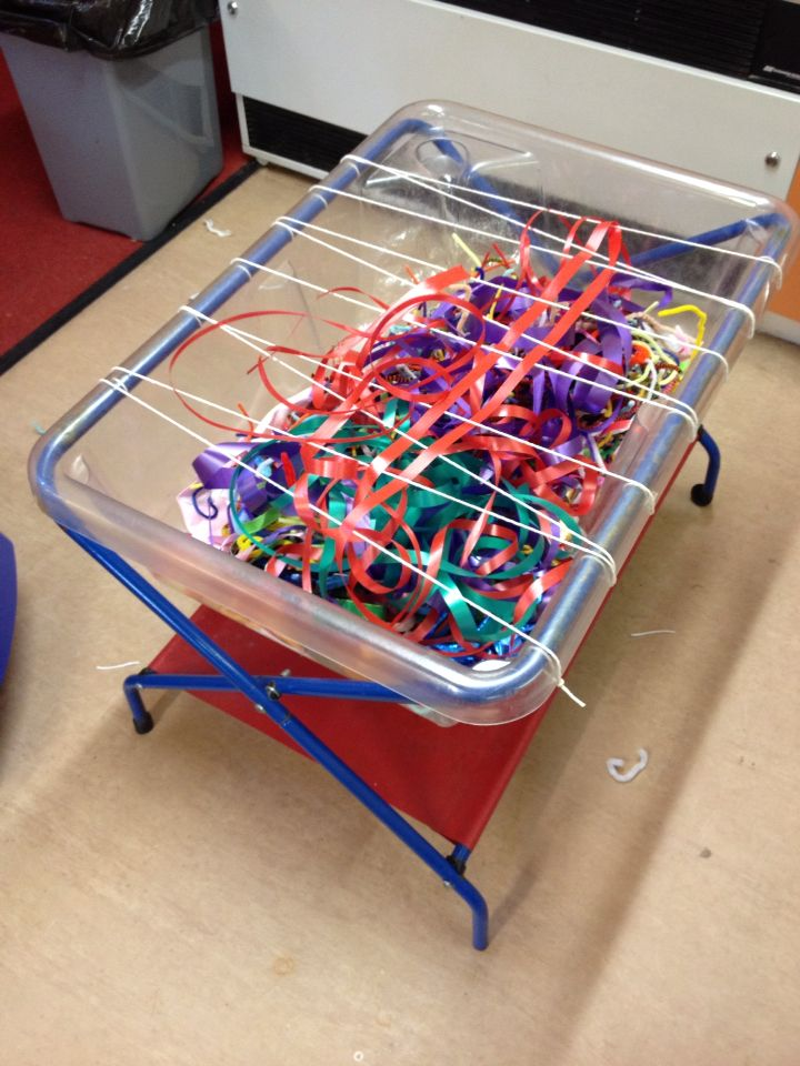 Ribbon tray with string for fine motor development.