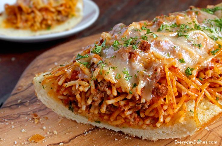 Enjoy all of your favorite elements of an Italian dinner with our garlic bread spaghetti sandwich recipe!