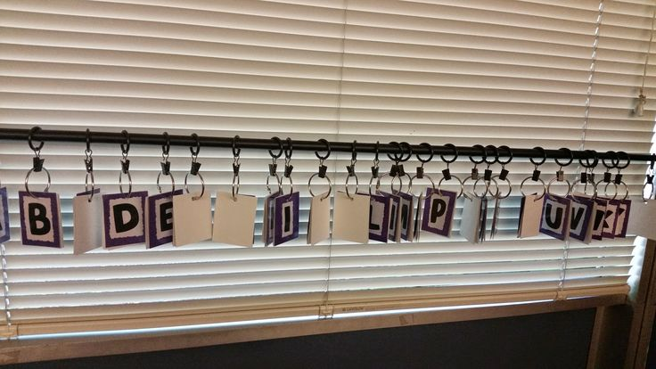 portable word wall on a curtain rod, kids can clip words that start with particular letter on and off to reference them                                                                                                                                                      More