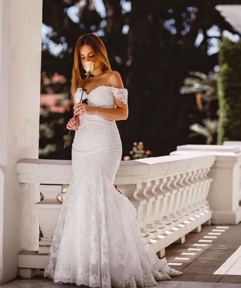 All Lace Morilee by Madeline Gardner Fit and Flare Wedding Dress. Embroidered lace appliqués. Style 5413. Shown customized with off the shoulder draping.