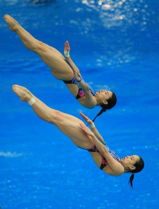 Guo Jinglin et Wu Minxia au plongeon synchronisé durant les JO de Beijing en 2008. © Liu Yu / Xinha News Agency