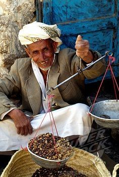 "selling coffee beans, Al Mukhalla, Yemen. Yemen may have been the first place to have a ""coffee-drinking"" culture, even though coffee was first discovered and used in Ethiopia."