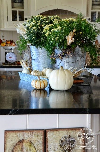 Fall Kitchen decor with pumpkins galvanized buckets with fall flowers. Gorgeous!