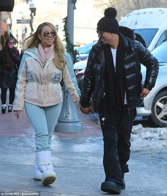 3a090c27e6 Loved up  Mariah was back to her typical glamour on Wednesday as she  bundled up in a Chanel ensemble while smiling with her handsome beau in the  tony ski ...