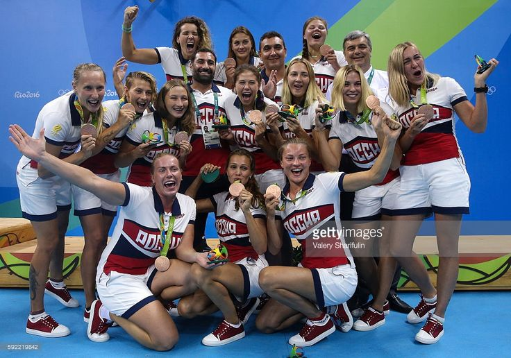 Alexander Gaidukov (L center), head coach of the Russian women's water polo team, and Bronze medalists, Russia's players at an award ceremony for the women's water polo event at the 2016 Summer Olympic Games, at Olympic Aquatics Stadium. Valery Sharifulin/TASS