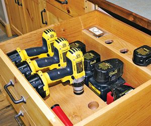 A drawer for drills: The drawer was designed to store cordless drills, batteries, and chargers. It is equipped with a timer to prevent chargers from overheating.