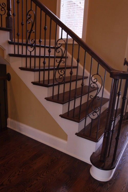 Wrought iron stair railing - uncarpeted stairs. There are tutorials on how to remove carpet from stairs and complete this look DIY on YouTube.