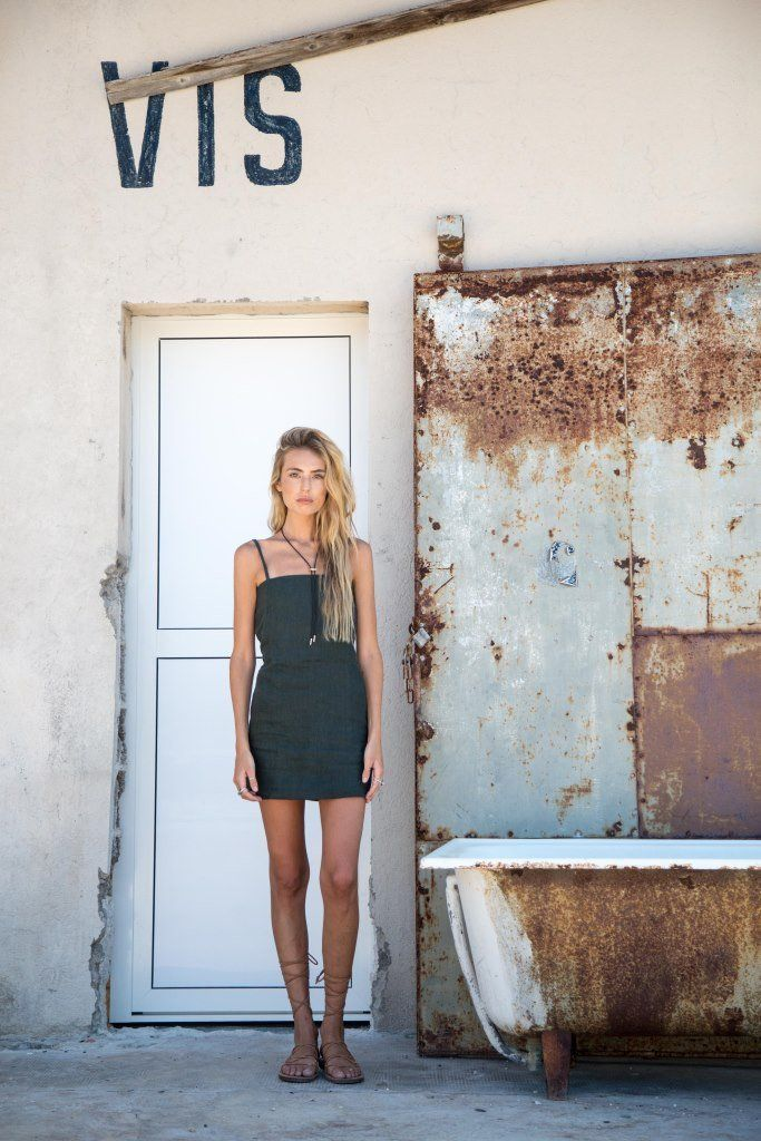 Linen mini dress with square neck line, thin strap detail and back tie detail with cut out. Centre back invisible zip entry. Designed to skim over the body. 100