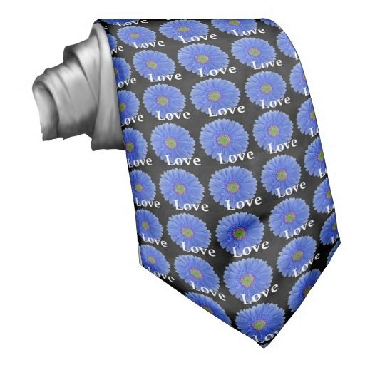 Unique, men's tie features a repeating pattern of medium blue gerbera daisies on a black background with the word Love. This custom tie is perfect for weddings, engagement parties, anniversaries, vow renewals, etc. Order for the groom, groomsmen, ushers, and fathers of the bride and groom for a fully coordinated wedding party. This same pattern also available in coordinating postage stamps, invitation seals, favor stickers, etc. #blue #love #black #green #gerbera #gerber #daisy #tie