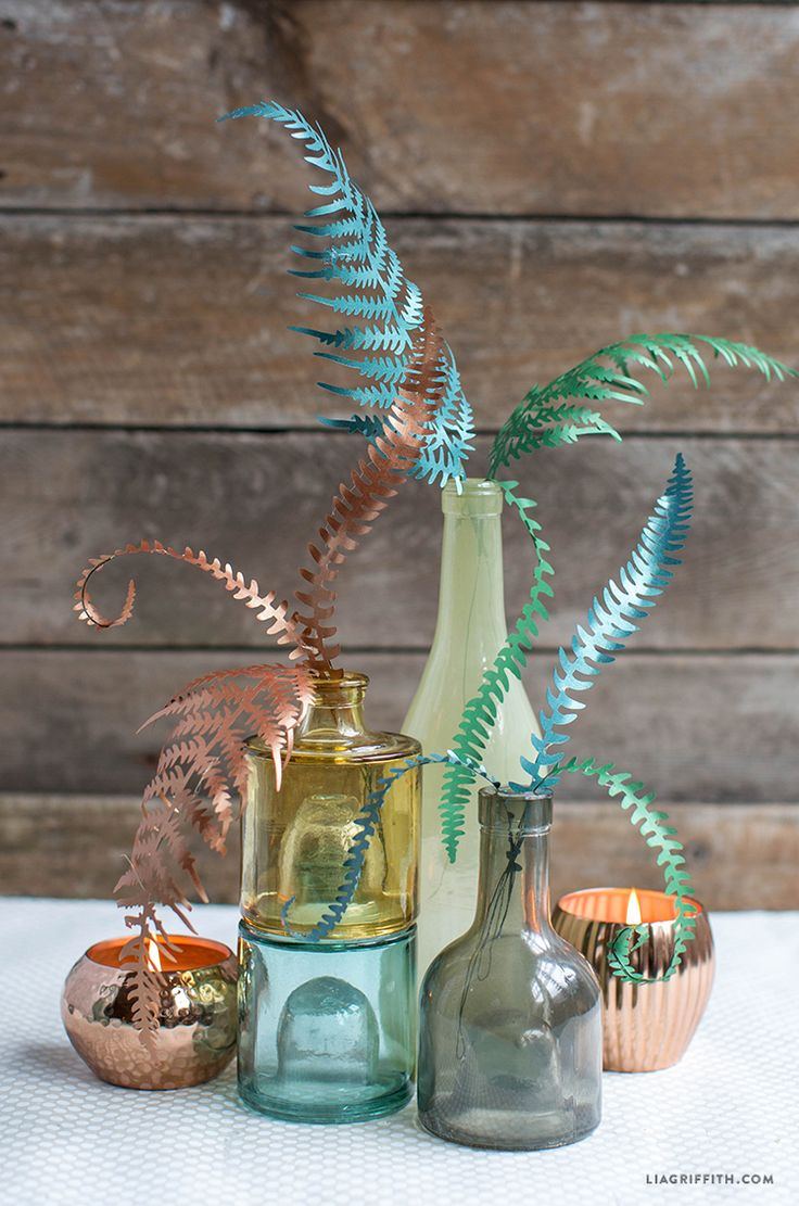 Make your own paper fern leaves in rich metallic papers, the perfect Fall DIY project. Design & template download by handcrafted lifestyle expert Lia Griffith