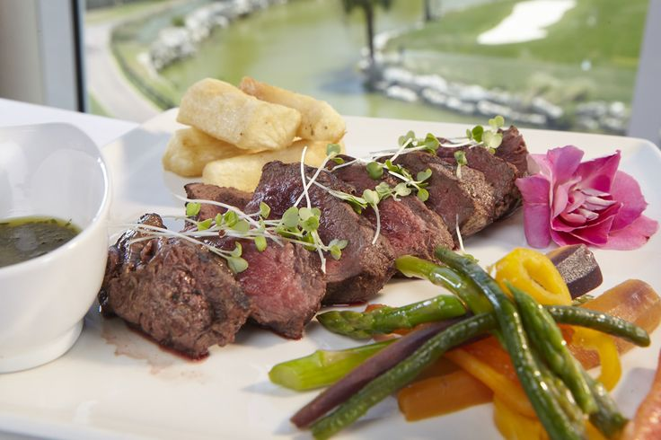 """Chateaubriand - """"el gaucho"""" churrassco style grass fed argentine beef chimmi-churri herb and garlic sauce with yucca fries"""
