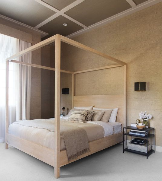 Custom canopy bed with bedside table.