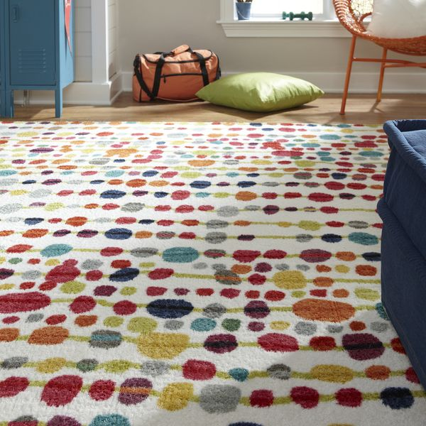Add a fun, funky touch to your living room or playroom with this contemporary rug from Delerus. The colorful dot pattern lifts your spirits and creates a playful vibe while adding a fresh splash of co