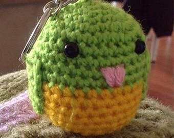 This cute little budgie would look great on your keychain, phone, bag or anywhere really.