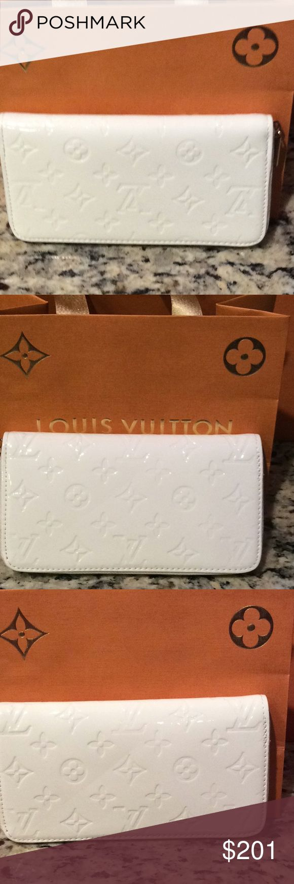 New Louis Vuitton off white full zip wallet Just make an offer All reasonable offers will be considered   This is a brand new Louis Vuitton off white full zip wallet with tons of card holding slots and a zipper inside for coins this is a really high quality INSPIRED or NOT AUTH piece i think bc i can't find a date stamp in it so I will sell this piece at a fraction of the cost of a real. The shopping bag in the background is not sold with this purse Louis Vuitton Bags Wallets