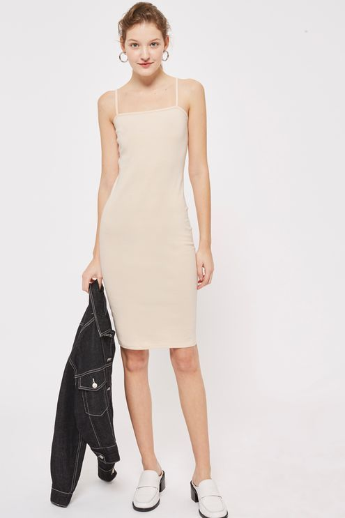 Nude bodycon dress with a square neck and midi in length.