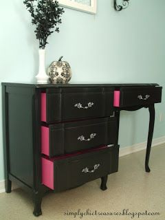 A tired-looking desk turns chic with a coat of glossy black paint, drawer insides painted a surprising hot pink, and damask drawer liners.  See the transformation at simplychictreasures.blogspot.ca