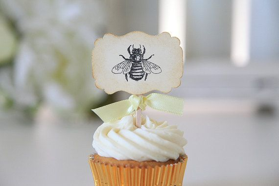 """Bumble Bee theme. These handmade vintage bumble bee themed cupcake toppers are so cute and they come with the option of having no ribbon; or, your choice of five ribbon colors that are typically used with this theme: Ivory, Light yellow, Brown, and Champagne, Gold.    Details:    -Made to order  -80lb cream cardstock  -Black ink  -Vintage theme  -Size: 2 ¼"""" wide x 1 ½"""" Tall, total Height: 4 ¼""""  -12 toppers    ~This listing is for the Bumble bee image only. You can also mix and match these…"""