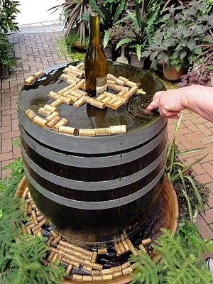 idea for a Pool of Tears- replace wine bottle with 'drink me' bottle and the barrel with a glass/transparent table.