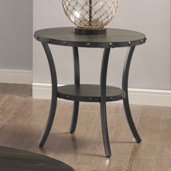 Enhance your home decor with this stylish Rich Toasted Coffee Bean and black finish end table. A shelf beneath the table provides storage space for magazines and other incidentals. The design is clean and timeless with dark metal playing against the wooden table top. Highlighted with brass nail-heads and studded wooden trim work around the table's edge for on-trend flair. This versatile living room end table is perfect to place drinks, magazines, and decorative displays.