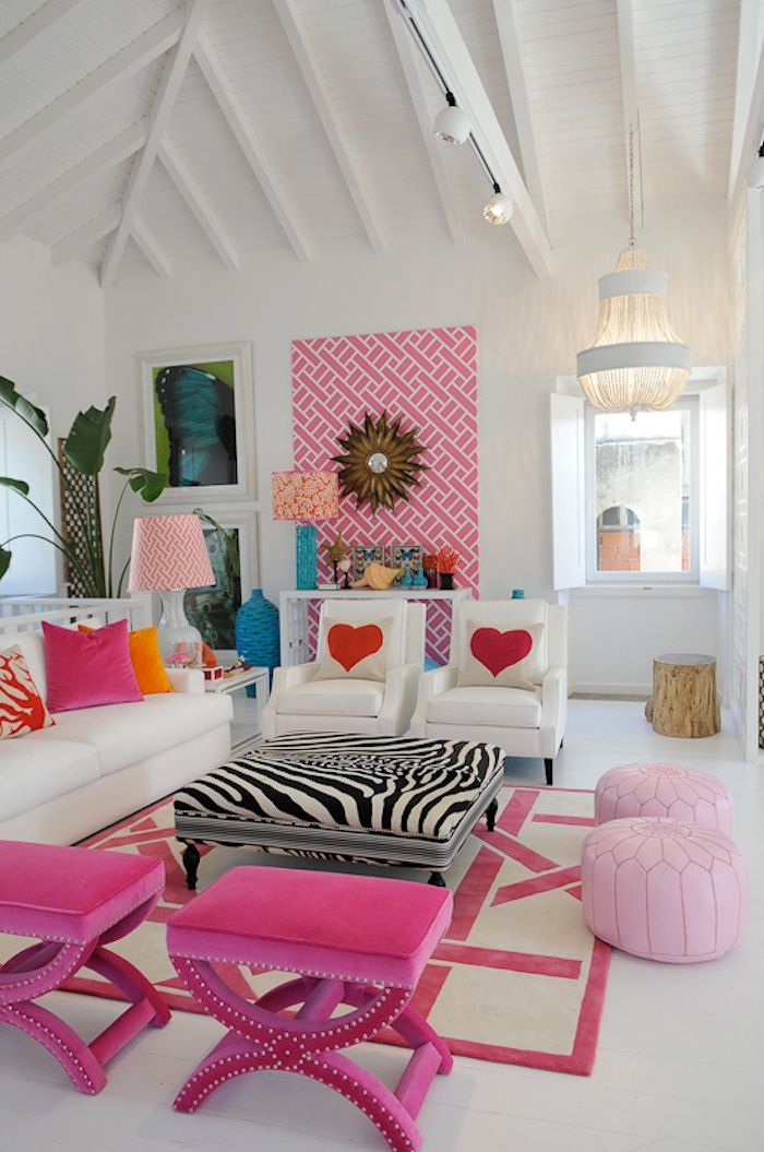White room with pops of color. I love the pink benches!