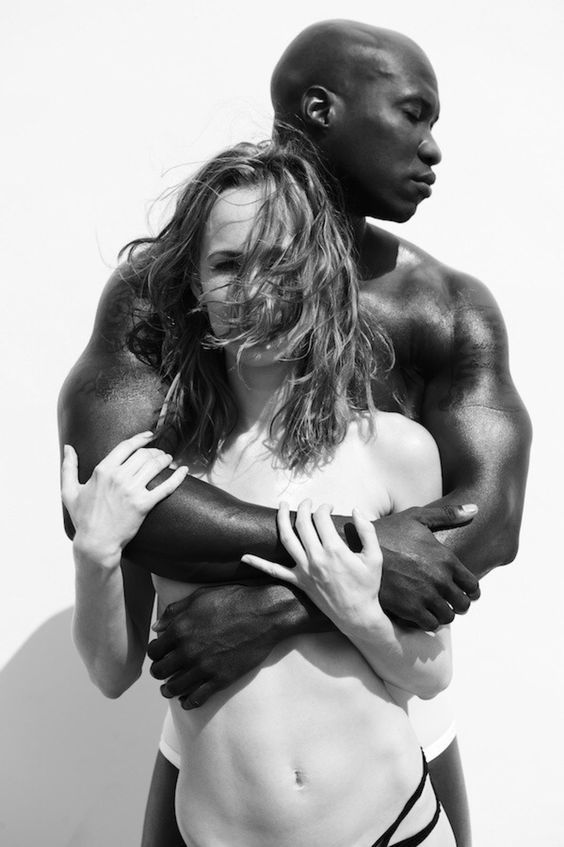 Couple kissing happiness fun interracial young stock photo
