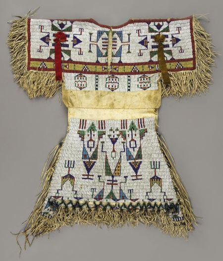 A BEAUTIFUL LAKOTA/SIOUX GIRL'S BEADED HIDE DRESS, circa 1880. (Back view shown).