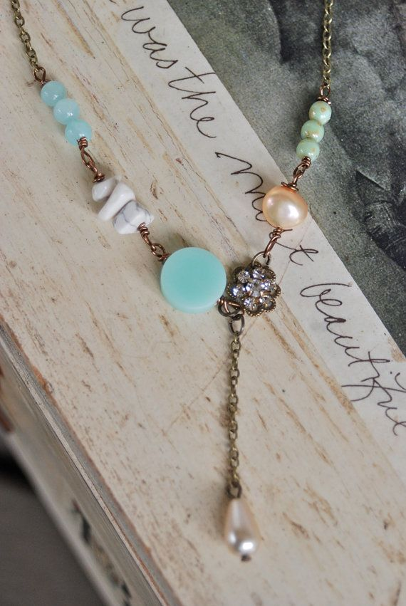 Summer romance.. sweeps you off your feet  features assorted glass beads,jade gemstones,white turquoise/howlite chips,crystal flower,freshwater pearl,vintage faux glass pearl drop,antique brass chain measures 17 drops 1 1/2