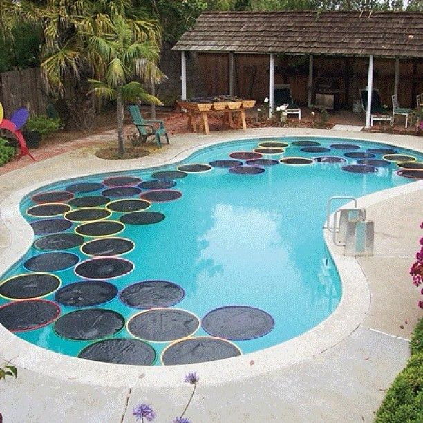Lilypad Pool Warmers - Using a hula hoop, and some cheap black plastic you can melt the plastic to the hula hoop - the black traps energy from the sun and heats up the pool. Very cheap and efficient way to warm up the water! #diy #home #backyard #pool