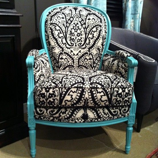 I love this chair with the black and white upholstery and turquoise painted trim.