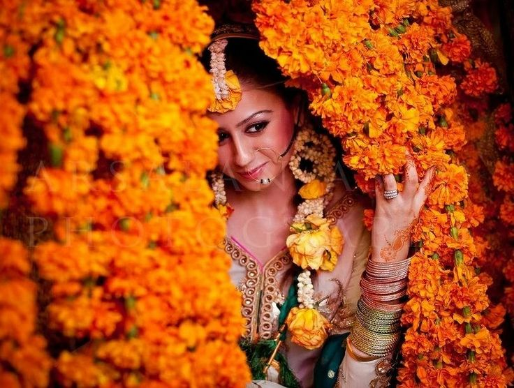 Mehndi,Pakistani wedding, Pakistani fashion, mehndi dress The bride is hidden in the flowers to show the significants of flowers at a mehndi