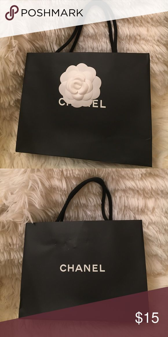 """Authentic Chanel Shopping Bag with Camellia Flower Authentic Chanel Shopping Bag with Camellia Flower.  8 5/8"""" W x 6 3/4"""" H x 2 3/4"""" D. CHANEL Bags"""